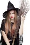 少妇画象巫婆服装的 免版税库存照片