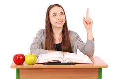 少年举手的学校女孩问问题 库存图片