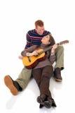 少年吉他的恋人 免版税库存照片