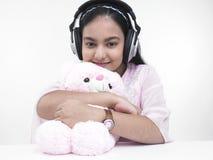 少年女孩的耳机 库存图片