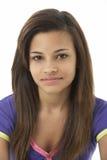 少年女孩纵向微笑的工作室 免版税图库摄影