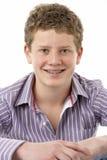 少年男孩纵向微笑的工作室 免版税库存照片