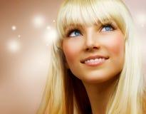 少年白肤金发的女孩的头发 库存图片