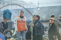 少数族裔在阳光下供以人员 库存图片