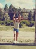 少数民族居住区街道锻炼,葡萄酒照片英俊的人 库存图片