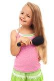 少许梳女孩头发 免版税库存照片