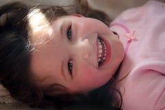 少许笑的女孩 免版税库存照片