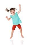 少许跳的女孩 免版税库存照片