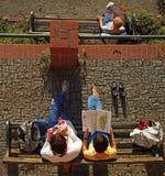 少量妇女是松弛在长凳在格拉茨 免版税库存照片