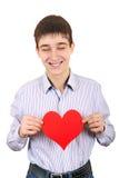 少年举行红色心脏形状 免版税图库摄影