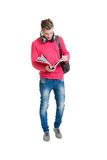 少年在白色隔绝的学生拿着袋子的和书 图库摄影