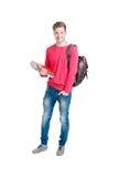 少年在白色隔绝的学生拿着袋子的和书 库存图片
