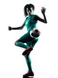 少年女孩儿童足球运动员被隔绝的剪影 免版税库存图片