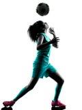 少年女孩儿童足球运动员被隔绝的剪影 免版税图库摄影