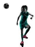 少年女孩儿童足球运动员被隔绝的剪影 库存照片