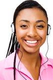 少年女孩愉快的听的音乐 免版税图库摄影