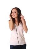 少年女孩耳机听的音乐 库存图片