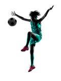少年女孩足球运动员被隔绝的剪影 库存图片