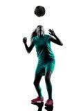少年女孩足球运动员被隔绝的剪影 库存照片
