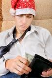 少年检查钱包 免版税图库摄影