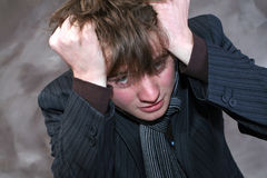 少年痛苦的头疼 图库摄影