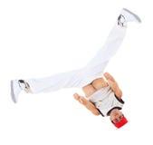 少年跳舞breakdance自己的行动 免版税库存图片