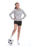 少年运动球英尺女孩球员的足球 免版税图库摄影