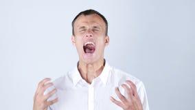 尖叫恼怒的商人的特写镜头  图库摄影