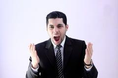 尖叫恼怒的商人 免版税库存照片