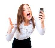 尖叫恼怒的女实业家 免版税库存图片