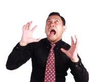 尖叫恼怒的疯狂的商人 免版税库存照片
