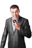 尖叫生意人电池的移动电话 图库摄影