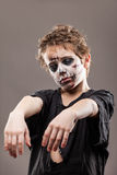 尖叫的走的死的蛇神儿童男孩 免版税图库摄影