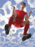 尖叫的足球运动员 免版税库存照片