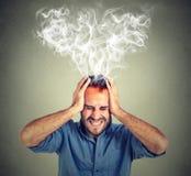 尖叫被注重的人认为太出来头的坚硬蒸汽 库存照片