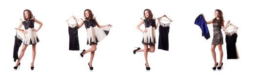 尝试在白色的少妇新的衣物 免版税库存图片