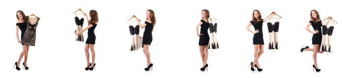 尝试在白色的少妇新的衣物 库存图片