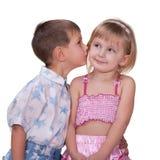 尝试第一个女孩亲吻 库存图片