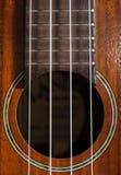 尤克里里琴吉他的特写镜头有串的 免版税库存照片