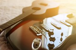 尤克里里琴和电吉他宏指令摘要 免版税库存图片