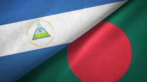尼加拉瓜和孟加拉国两旗子纺织品布料,织品纹理 免版税库存照片