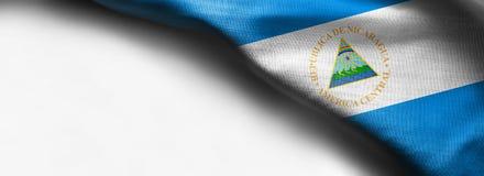 尼加拉瓜旗子旗子在白色背景的 库存照片