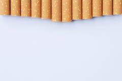 从尼古丁概念,以牙的形式香烟的作用 图库摄影
