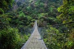 尼泊尔吊桥Langtang谷 库存照片