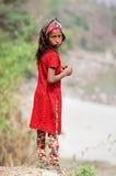 尼泊尔女孩画象红色礼服的 免版税库存图片