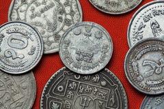 尼泊尔的硬币 在山的印度trishul 免版税库存照片