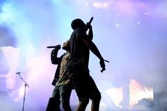 尽快从哈林的岩石Hip Hop集体的交谈者和成员在音乐会尽快围攻在生波探侧器节日 图库摄影