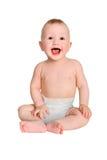 尿布的微笑的小男孩在被隔绝的白色背景 免版税库存图片