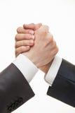 展示冲突或固体的姿态的商人的手 免版税图库摄影