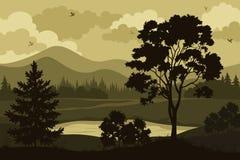 山、树和湖 免版税库存照片